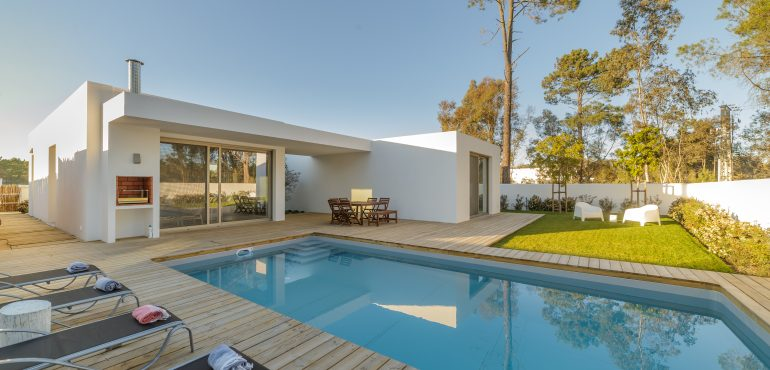 Modern house with swimming pool and wooden deck